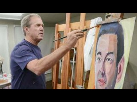 President George W  Bush honoring wounded veterans with portraits