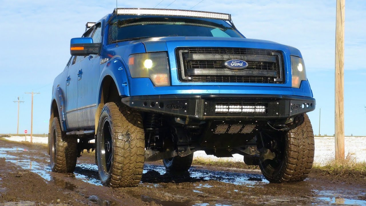 Lifted Ford F150 >> Lifted Ford F-150 4x4 hits a Mud Puddle on Icy Dirt Road ...