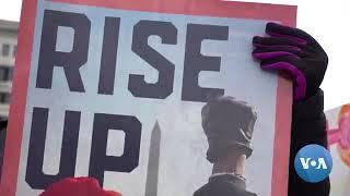 Women's March in Washington Brings Heat on a Wintry Day