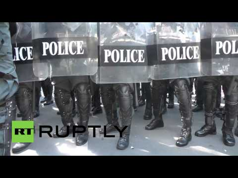 Thailand: Police guard HQ after Shinawatra survives no-confidence vote