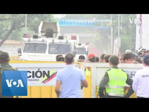 Venezuela Troops Smash Through Barrier and Desert to Colombia