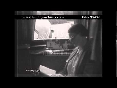 Woman sits in a Caravan as it is towed.  Archive film 95439