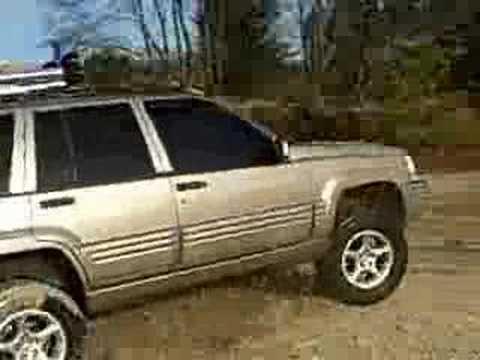 5.9 grand cherokee off road getting wet wide open exhaust