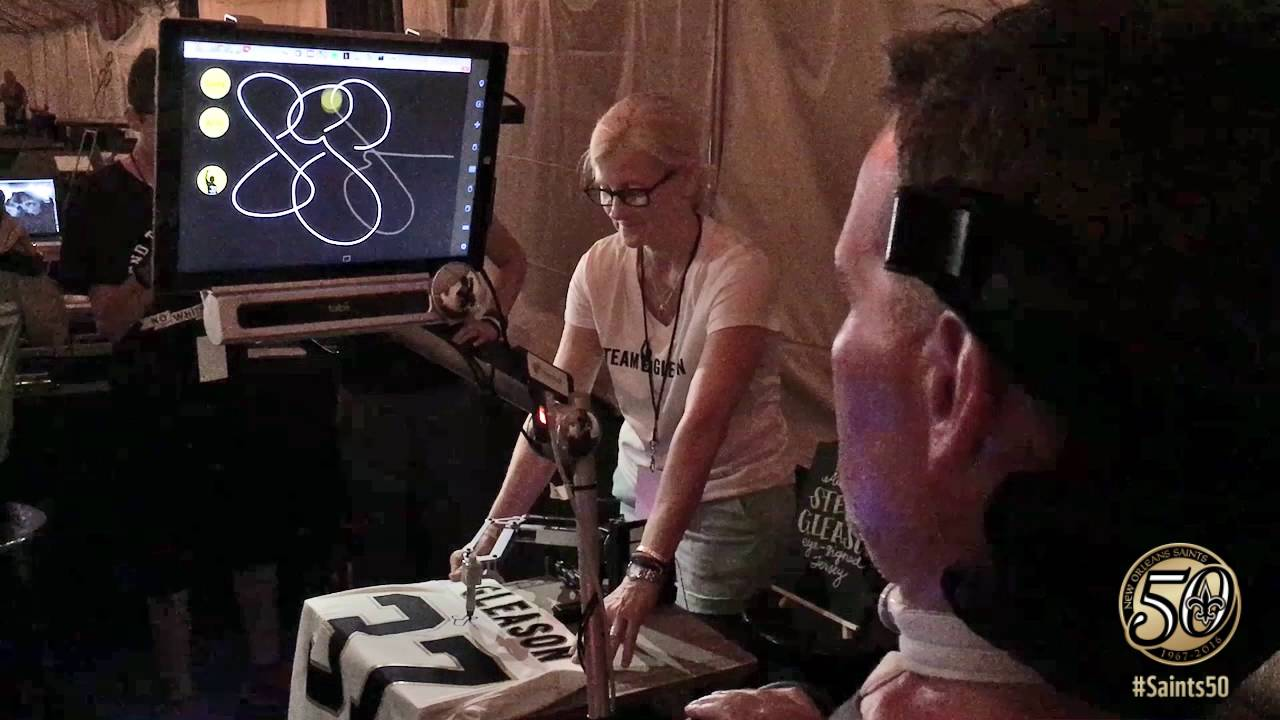 127f620a4 Steve Gleason autographs a jersey with his eyes - YouTube