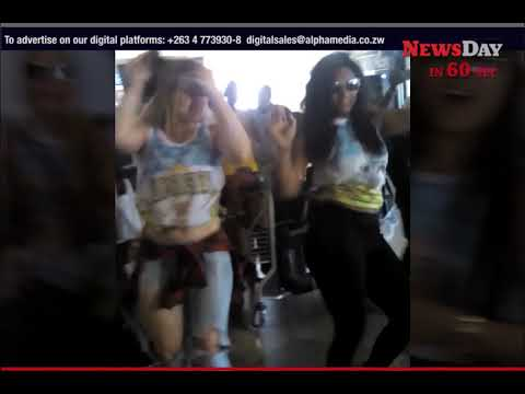 Samba girls teaser dances as they arriver for Harare Carnival 2017