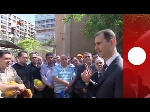 Defiant Assad visits Damascus power plant