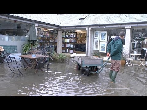 Dartmouth uk floods in Victoria rd  and the Conservative club & Market Square 18/01/2014 BBC News.