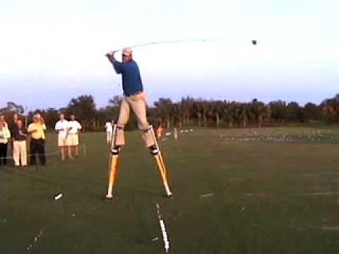 Trick Shot Guy Brad Denton hits 10ft club on stilts