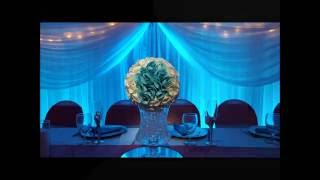 Cedars Banquet Hall with teal and coral wedding lighting by Duluth Event Lighting