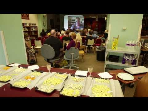 Author Gordon Edgar speaks via Skype to a gathering of library patrons in Butte, Montana.
