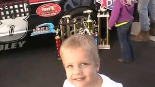 Kid sits in Jake Bradleys Race Car