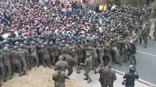 video: Watch: Migrant caravan clashes with Guatemalan police on way to Mexico and US