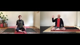 1. Angela Lane guides Andrew Kelly in a brief yoga sequence.