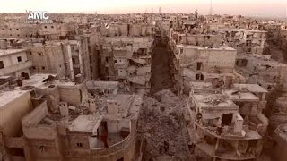 Drone Video Shows Destruction in Aleppo From the Air(New drone footage shows a birds-eye view of Aleppo, once Syria's thriving commercial center, now where homes and other buildings have been destroyed by ..., 2016-10-11T18:37:31.000Z)