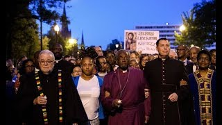 Royal wedding bishop Michael Curry marches against Trump's 'America First' agenda
