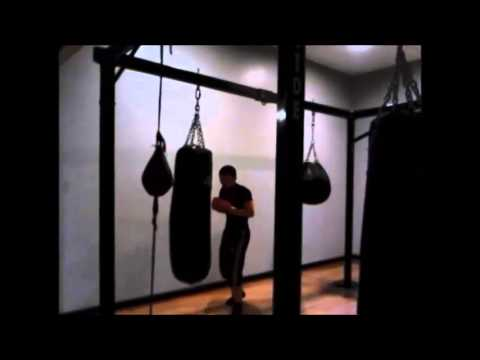 Punching Heavy Bag Speed Combination Practice At Golds Gym Boxing Class Room
