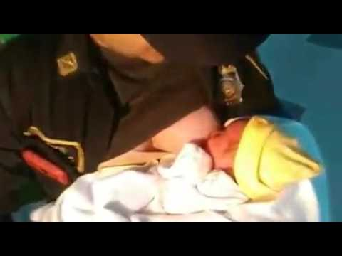 Colombian officer breastfeeds abandoned baby