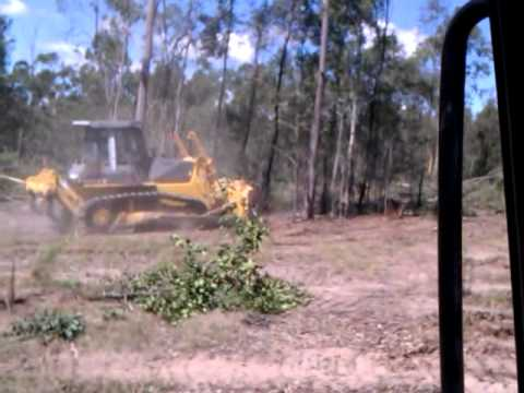 dozer clearing trees