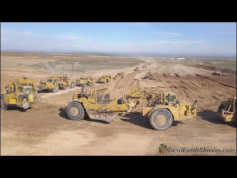 Digging New Landfill Cell With Fleet Of Caterpillar Scrapers (Part 1)