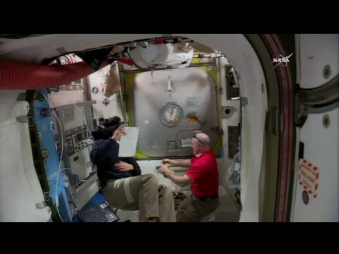 LIVE – Astronauts conduct a spacewalk outside the space station