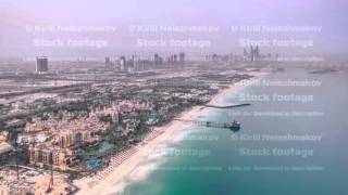 Dubai Marina Skyline night to day from Burj Al Arab. United Arab Emirates timelapse