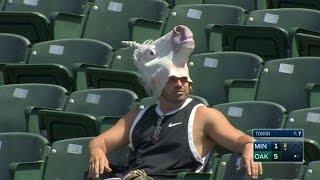 MIN@OAK: A fan in a unicorn mask roots on the A