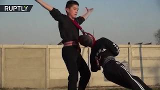 Young Chinese acrobats perform daring stunts