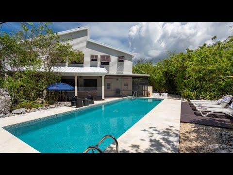 Arcosanti | Beach Bay | Cayman Islands Sotheby's International Realty