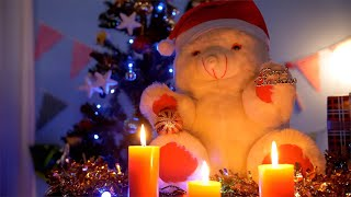 Bokeh shot of a cute teddy bear wearing Santa hat in a dark room on Christmas Eve - India