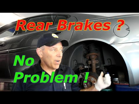 How To Replace Rear Disc Brakes And Rotors On A Pontiac Grand Prix