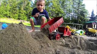 Little kid Drives Dump Truck