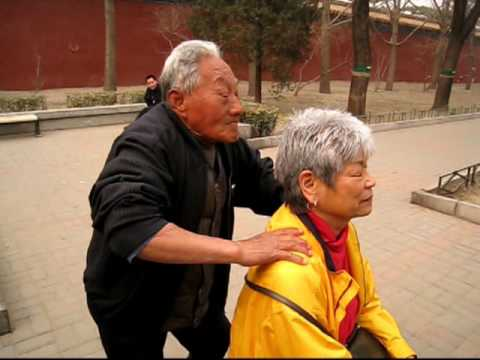 Massage in front of Forbidden City
