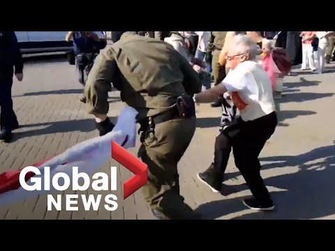 Belarus protests: Police wrestle flag from elderly demonstrator during ongoing protests