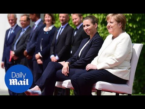 Merkel uses chair during Denmark PM arrival day after shaking bout