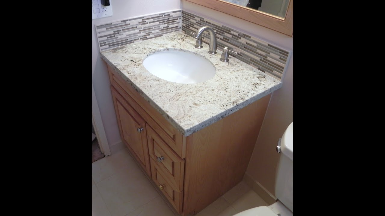 How to install vanity granite top stone glass backsplash - How to install a bathroom vanity ...