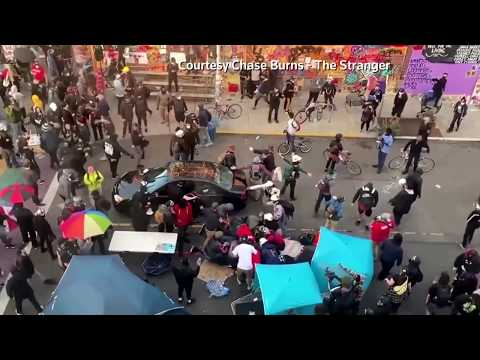WARNING: GRAPHIC CONTENT - Man drives car into Seattle protesters, shoots bystander