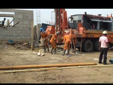 Drilling bore hole for water.