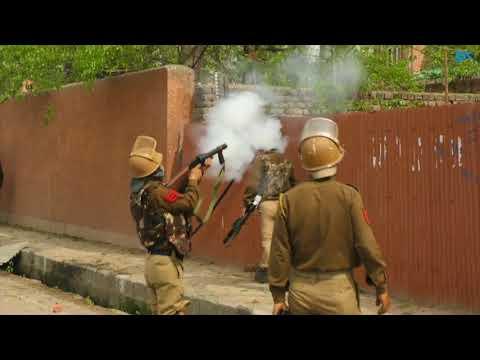 Protesting students torch police picket during clashes near Bakshi stadium in Srinagar