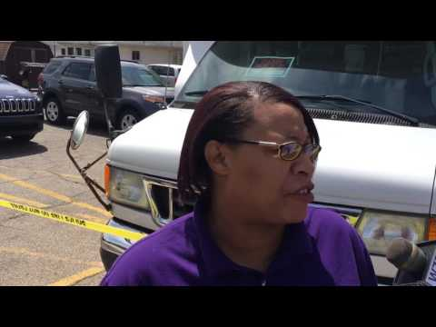 Woman reacts to man shot on front lawn in Grand Rapids Police shooting