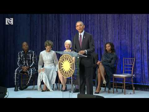 Obamas return to stage for official portraits unveiling