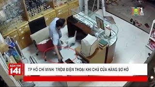 Hình ảnh về kẻ trộm đánh cắp điện thoại tại cửa hàng | Tin nóng 24H | Nhật ký 141