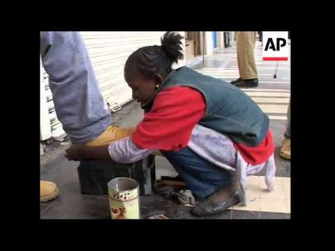Ethiopian girl pays for education by shining shoes - 2006 thumbnail