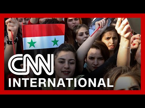 Syrians vote in 'sham' election set to be won by Assad
