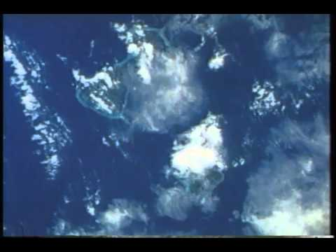 Space Shuttle Discovery over Bora Bora, atoll Motu