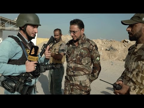 EXCLUSIVE - With the journalists on the frontline in Iraq