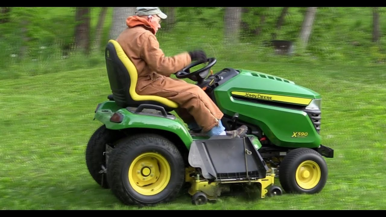 2015 x590 john deere lawn tractor cutting and mowing grass for Lawn mower cutting grass