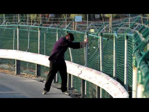 Jet Blast - Lone Fence Surfer At St. Maarten (SXM) Gone With The Wind! - March 1, 2012