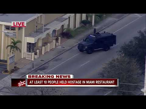 Police: Managers hold nearly 12 employees hostage at club in Miami
