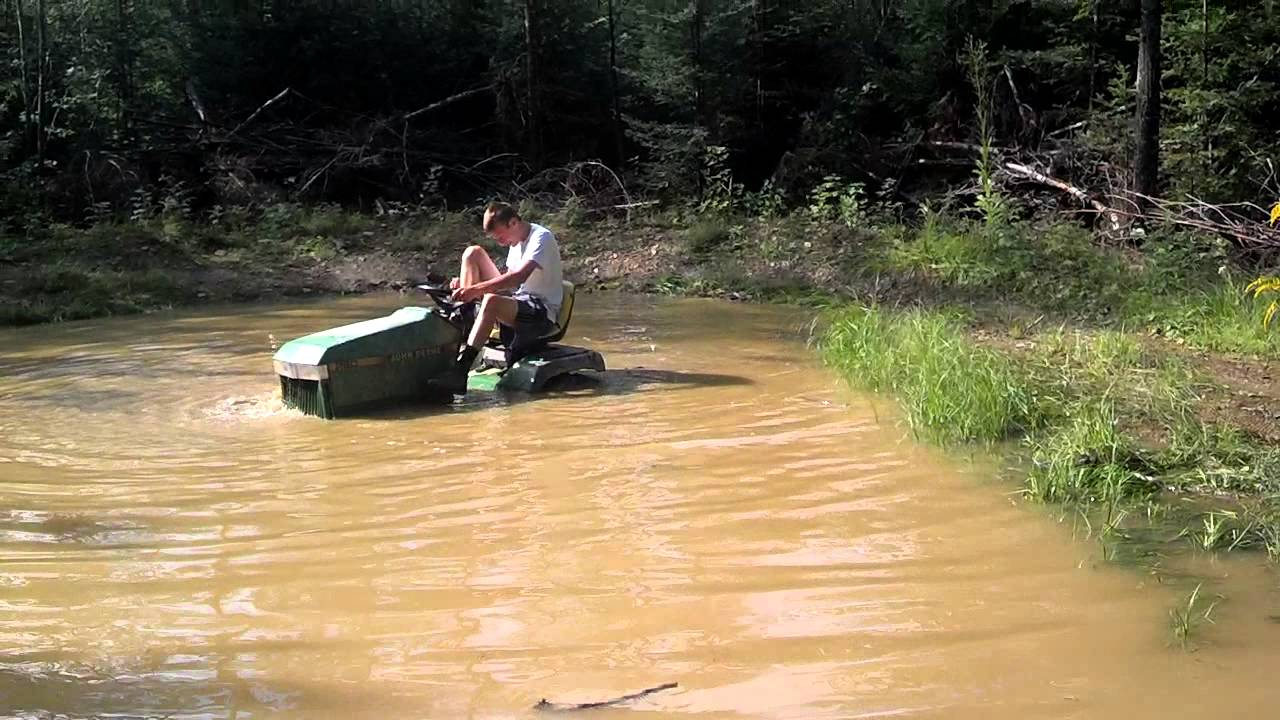 Tractor Going Right On Man : Going through deep water with a lawn tractor youtube