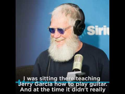 David Letterman shows Jerry Garcia how to play guitar